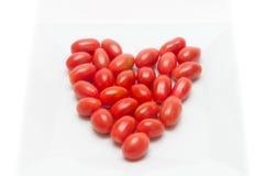 Κόκκινες διαμορφωμένες καρδιά ντομάτες Στοκ Εικόνες