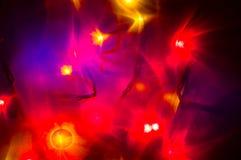 Κόκκινες και κίτρινες διακοπές bokeh αφηρημένα Χριστούγεννα ανασκόπησης Στοκ Εικόνα