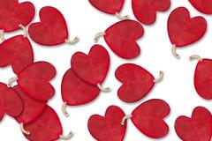 Κόκκινες καρδιές φύλλων στο άσπρο υπόβαθρο Στοκ εικόνα με δικαίωμα ελεύθερης χρήσης