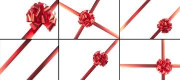 κόκκινες κορδέλλες δώρων τόξων Στοκ Φωτογραφίες