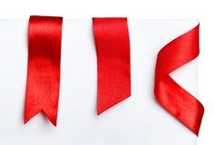Κόκκινες κορδέλλες σελιδοδεικτών Στοκ Εικόνες