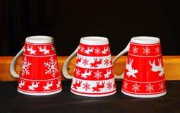 Κόκκινες κούπες Χριστουγέννων Στοκ Φωτογραφία