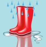 Κόκκινες λαστιχένιες μπότες με τις απελευθερώσεις και τον παφλασμό βροχής ελεύθερη απεικόνιση δικαιώματος