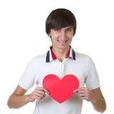 κόκκινες νεολαίες ατόμων εκμετάλλευσης καρδιών στοκ φωτογραφία