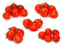 Κόκκινες ντομάτες καθορισμένες απομονωμένες σε ένα άσπρο υπόβαθρο Στοκ Φωτογραφίες