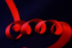 κόκκινες ρέοντας ταινίες Στοκ Εικόνες
