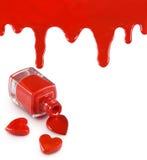 κόκκινες στιλβωτική ουσία και καρδιά καρφιών σε ένα άσπρο υπόβαθρο Στοκ Εικόνες