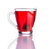 Κόκκινες τσάι και τσάντα που απομονώνονται στο άσπρο υπόβαθρο Στοκ Εικόνες
