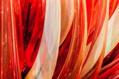 Κόκκινες φλόγες γυαλιού, μέρος του αντικειμένου γυαλιού, λεπτομερής άποψη Στοκ Φωτογραφία