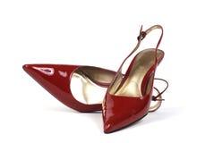 κόκκινες s φορεμάτων γυναίκες παπουτσιών ζευγαριού Στοκ εικόνα με δικαίωμα ελεύθερης χρήσης