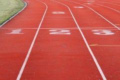 κόκκινη αθλητική διαδρομ στοκ εικόνα με δικαίωμα ελεύθερης χρήσης