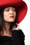 κόκκινη γυναίκα καπέλων αρκετά στοκ εικόνα