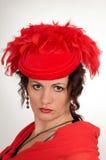 κόκκινη γυναίκα καπέλων Στοκ Φωτογραφία