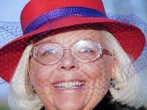 κόκκινη γυναίκα καπέλων Στοκ Φωτογραφίες