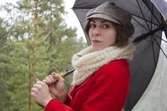 κόκκινη γυναίκα σακακιών Στοκ φωτογραφία με δικαίωμα ελεύθερης χρήσης