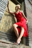 κόκκινη γυναίκα φορεμάτων Στοκ Φωτογραφίες