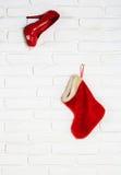 Κόκκινη γυναικεία κάλτσα παπουτσιών και Χριστουγέννων Στοκ Εικόνες