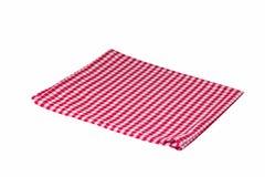 Κόκκινη εγκλωβισμένη πετσέτα που απομονώνεται στο άσπρο υπόβαθρο Στοκ εικόνα με δικαίωμα ελεύθερης χρήσης