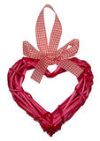 Κόκκινη ημέρα βαλεντίνων καρδιών που υφαίνεται από τους κλάδους της ιτιάς στοκ εικόνα