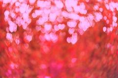 Κόκκινη θαμπάδα υποβάθρου βαλεντίνων καρδιών Στοκ Φωτογραφία