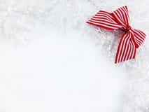 Κόκκινη διακόσμηση Χριστουγέννων κορδελλών Στοκ Φωτογραφία