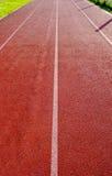 Κόκκινη και άσπρη τρέχοντας διαδρομή γραμμών Στοκ Φωτογραφίες