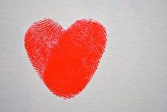 Κόκκινη καρδιά δακτυλικών αποτυπωμάτων Στοκ εικόνα με δικαίωμα ελεύθερης χρήσης