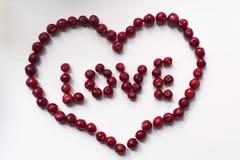 Κόκκινη καρδιά σε ένα άσπρο υπόβαθρο, κεράσι Στοκ Εικόνα