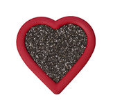 Κόκκινη καρδιά σπόρου Chia στο λευκό Στοκ φωτογραφία με δικαίωμα ελεύθερης χρήσης