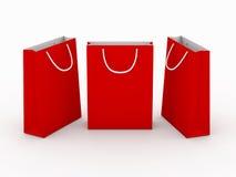 Κόκκινη κενή τσάντα αγορών με το ψαλίδισμα της πορείας ελεύθερη απεικόνιση δικαιώματος
