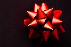 κόκκινη κορδέλλα τόξων αν&alpha Στοκ Εικόνες