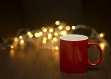 Κόκκινη κούπα καφέ bokeh Στοκ Εικόνες
