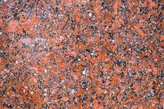 Κόκκινη μαύρη πέτρα υποβάθρου, μάρμαρο Στοκ φωτογραφίες με δικαίωμα ελεύθερης χρήσης