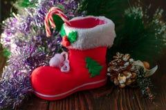 Κόκκινη μπότα Χριστουγέννων - διακόσμηση για τη ημέρα των Χριστουγέννων Στοκ Εικόνες