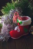 Κόκκινη μπότα Χριστουγέννων - διακόσμηση για τη ημέρα των Χριστουγέννων Στοκ φωτογραφία με δικαίωμα ελεύθερης χρήσης