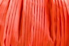 Κόκκινη πτυχωμένη σύσταση υφασμάτων υφάσματος για το υπόβαθρο στοκ φωτογραφίες με δικαίωμα ελεύθερης χρήσης