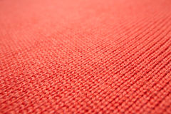 Κόκκινη πλεκτή σύσταση υφάσματος Στοκ εικόνα με δικαίωμα ελεύθερης χρήσης