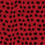 Κόκκινη σύσταση γουνών με τα σημεία Στοκ Φωτογραφίες