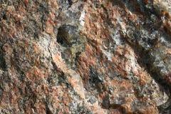 Κόκκινη σύσταση πετρών γρανίτη Στοκ φωτογραφία με δικαίωμα ελεύθερης χρήσης
