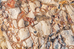 Κόκκινη σύσταση της σύστασης πετρών θάλασσας Στοκ φωτογραφία με δικαίωμα ελεύθερης χρήσης