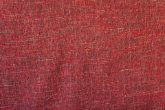 Κόκκινη τραχιά σύσταση υφασμάτων στοκ φωτογραφία