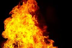 Κόκκινη φλόγα πυρκαγιάς στο μαύρο υπόβαθρο Στοκ Φωτογραφίες