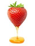 Κόκκινη φράουλα μούρων με την καραμέλα ή το μέλι Στοκ Εικόνες