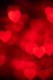 Κόκκινη φωτογραφία υποβάθρου καρδιών bokeh, αφηρημένο σκηνικό διακοπών Στοκ Φωτογραφίες