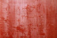 Κόκκινη χρωματισμένη σύσταση συμπαγών τοίχων Στοκ Φωτογραφία