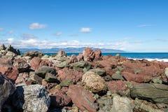 Κόκκινοι βράχοι, NZ Στοκ Φωτογραφία