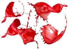 Κόκκινοι παφλασμοί χρωμάτων που απομονώνονται σε ένα άσπρο υπόβαθρο Στοκ εικόνα με δικαίωμα ελεύθερης χρήσης