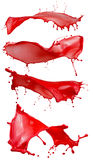 Κόκκινοι παφλασμοί χρωμάτων που απομονώνονται σε ένα άσπρο υπόβαθρο Στοκ Εικόνες