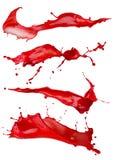 Κόκκινοι παφλασμοί χρωμάτων που απομονώνονται σε ένα άσπρο υπόβαθρο Στοκ Φωτογραφία