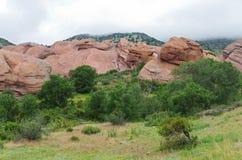 Κόκκινοι ψαμμίτης και βουνά του Glen βράχων Στοκ Εικόνες